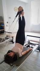 a man performing long spine exercise on Pialtes Reformer