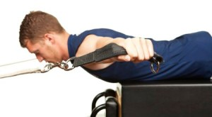 a man performing reformer exercise